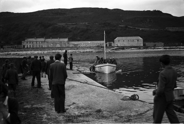 C022.24.00005 1955 Location Rathlin Island Photographer Michael J Murphy Relevant persons Jimmy McCurdy's boat arriving at pier Church Bay Rathlin from Ballycastle_0.jpg