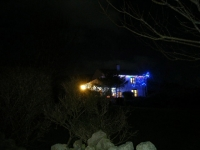 Liam & Alison McFaul's house lights from the road at Cleggan.