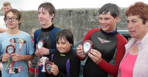 Marina with the happy junior winners: Phillip, Aaron, Eoin & Conor. Photo: DQM