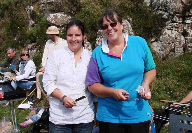 Julie-Ann McMullan and Liz Withers working hard on the barbeque. Photo: MB