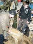 Loughie checks the shaping of Cathal's hull.