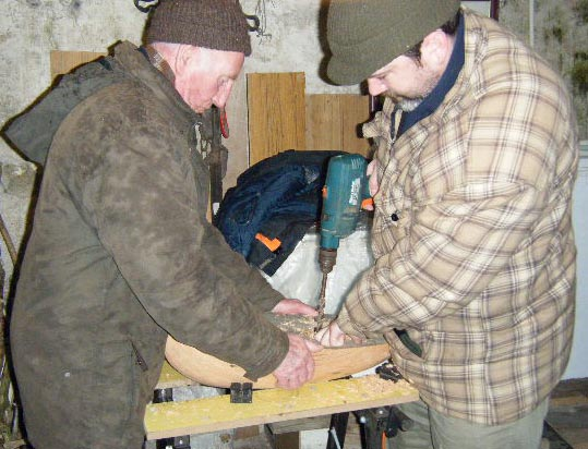 Loughie helps Stephen with the hollowing of the hull. Photo: MG