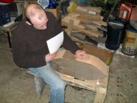 Brian checks the progress of the chiselling of his hull. Photo: SR