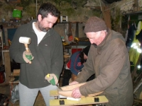 Stephen and Loughie work on the gouging out of the hull. Photo: Douglas Cecil
