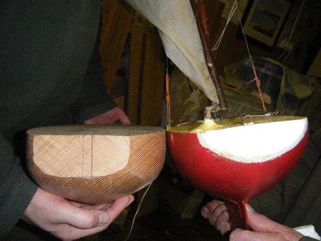 Stephen and Loughie compare the size and shape of the sterns of the new hull and Loughie's boat. Photo: Brian Teggart