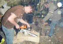 James and Cathal chainsawing one of the new blocks, while Brian continues the chiselling of his hull. Photo: SR.