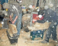 A sawdust snowstorm as James and Cathal plane their blocks. Photo: SR.