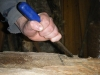 A close-up of James chiselling his hull.