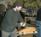 Stephen begins the nerve-wracking work of sawing the groove for the keel. Photo: Marianne Green