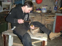 Cathal works on the gouging of his hull. Photo: SR