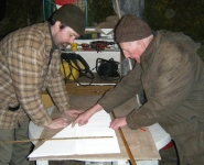 Stephen and Loughie work on the cutting of the sail material. Photo: Marianne Green