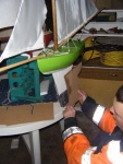 Douglas checks the keel of his latest boat against the template. Photo: SR