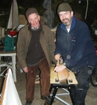Loughie and Stephen continuing work on the shaping of the hull. Photo: Douglas Cecil