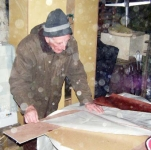 Loughie working on the sails for Douglas' boat. Photo: SR