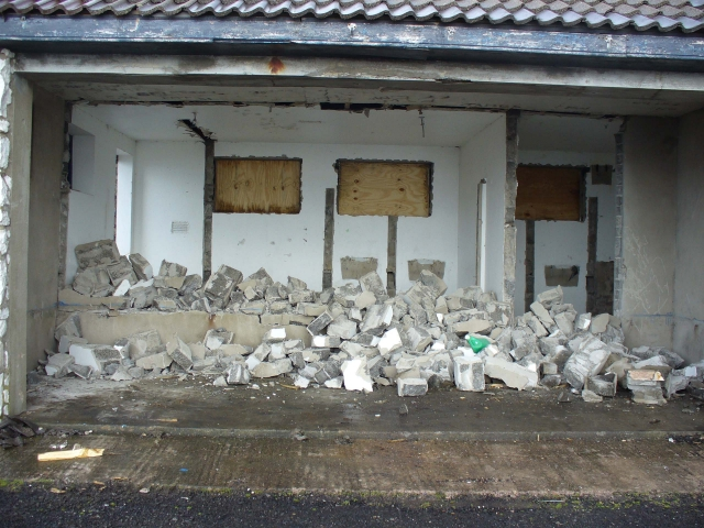 Demolition of the dividing wall between the public shelter and one of the toilets.